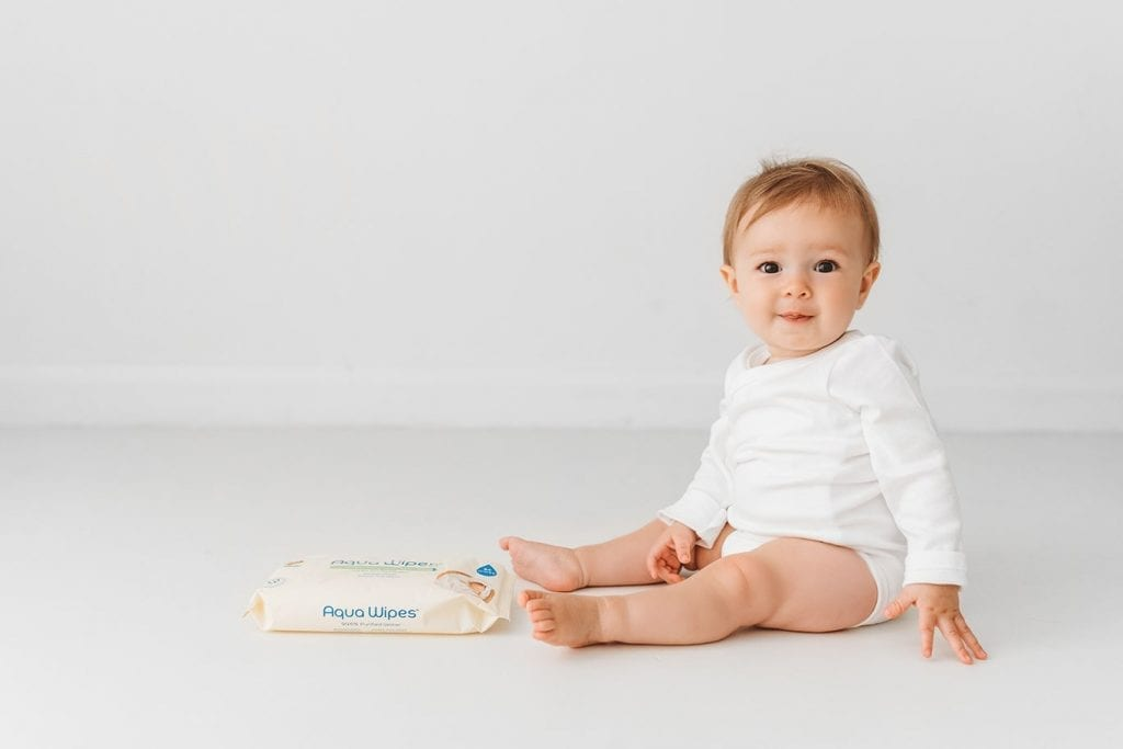 Baby with Aqua Wipes pack